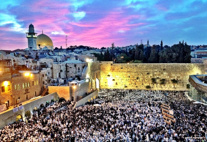 Crowds praying at dawn at the Western Wall in Jerusalem, Israel.